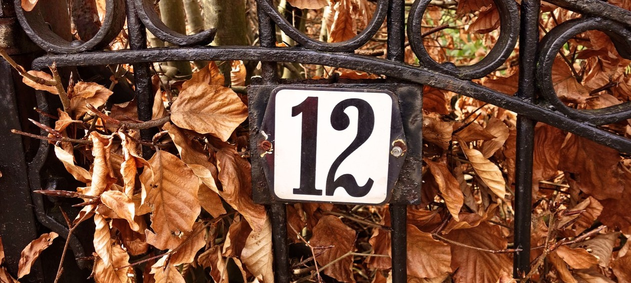 Wrought iron gate with Number 12 on it