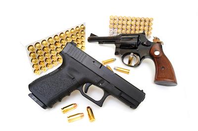 two handguns and bullets on display