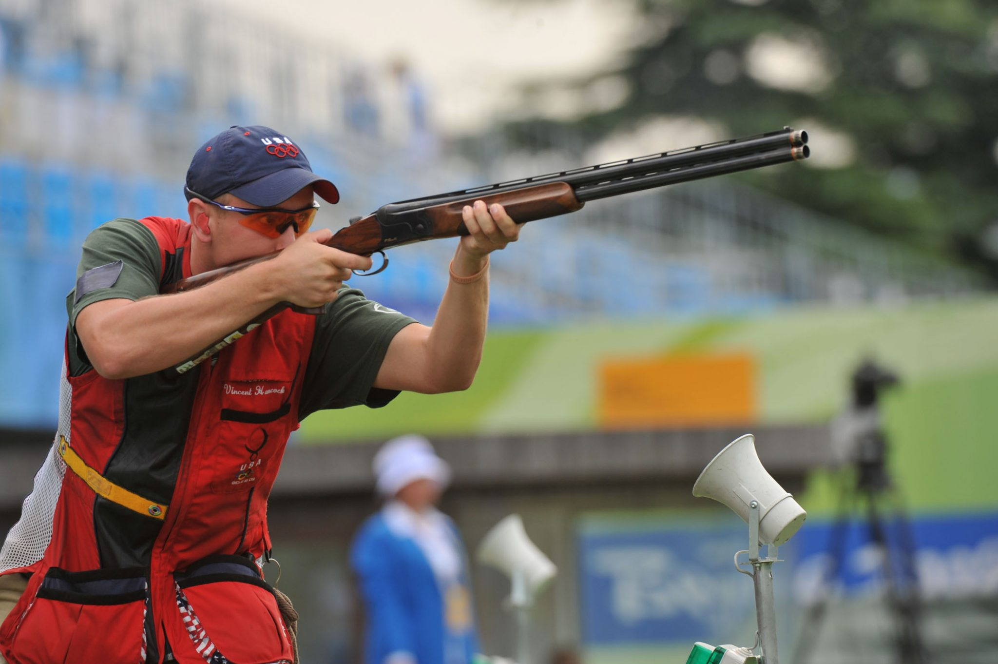 man shoots a sporting rifle in Olympics